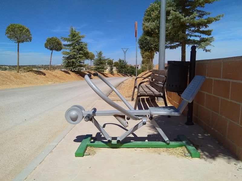 Sun, Sweat, and Exercise - Outdoor Fitness Equipment Beside of the Road