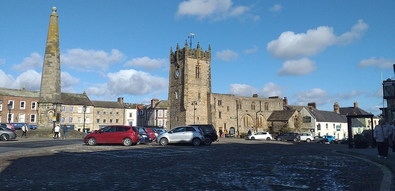 Richmond Market Place with the Town Cross on the Left and the Old Church (now the Green Howards Regimental Museum) in the Center