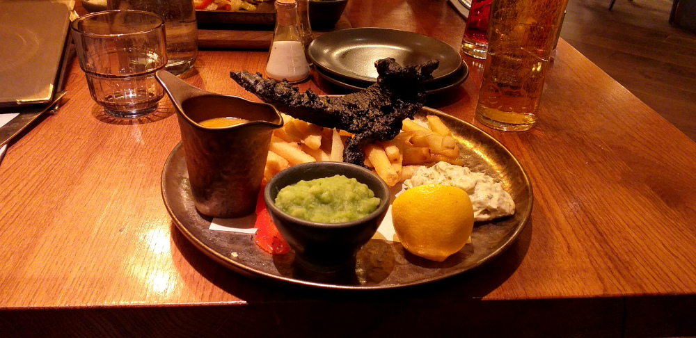 Black Fish and Chips at the Alchemist in Eldon Square, Newcastle-upon-Tyne. The fish isn't burnt. It's meant to look that way.